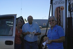 Val, Lou, and Linda having lunch by the fuel pump island at the Circle K in Florence, AZ.