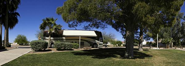 A panorama of our motorcoach parked at RVillage World Headquarters in Arizona City, AZ.