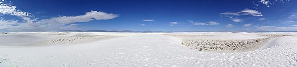 A panoramic photo of part of the White Sands National Monument.  The loop road only goes through a small portion of the dunes.