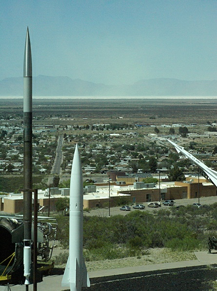 """The view to the west from the 4th floor of the New Mexico Space History Museum.  The """"white sands"""" are visible on the horizon and blowing into the air."""