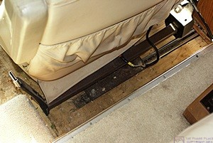 Villa passenger seat in our H3-40 showing inside edge of mounting plate and studs with nus.  (Front of coach to the left).