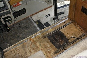 The entry stairwell and passenger seat area of our H3-40.  Note the two mounting channels for the passenger seat