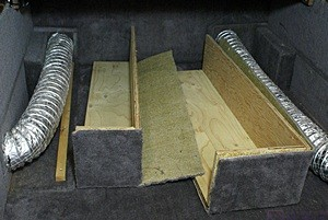Under-bed storage compartment with bot HVAC ducts uncovered.
