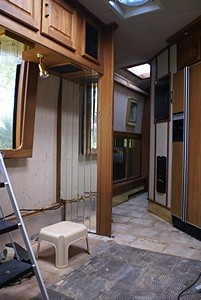 A view from the kitchen of the dinette corner and hallway.  A custom desk will go where the dinette seating used to be and double as work surface for the kitchen.