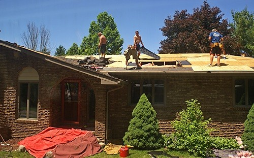 Installing soffit baffles and replacing roof decking on the front of the main roof.