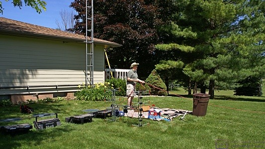"Setting up the tools and parts outside the ""drop zone"" of the 40-foot tower on the east end of the house."