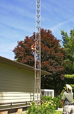 Starting up the tower from the roof of the house.  (Photo by Linda)