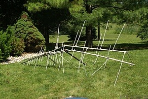 The old OTA TV antenna and mast on the ground.  It came down by the gravity method.  (Photo by Linda)