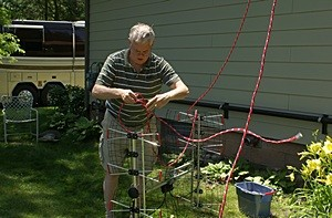 "Mike ties off the DB8e OTA TV antenna with an inverted ""Y"" so it will haul up in the proper orientation.  (Photo by Linda)"