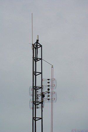 The top of the 40-foot tower from the WNW showing all of the antennas and the pulley with the haul rope.  The weather had definitely deteriorated from the day before.