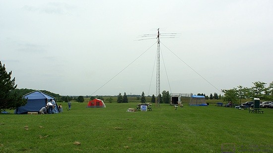 The larger of the two towers is up and secured.  It has a 6m beam antenna on top of 20m beam antenna on a common mast with a rotator.  We also attached one end of an off-center-fed dipole to this tower.