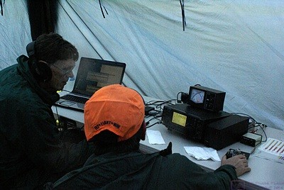 The SLAARC Field Day operating stations use wirelessly networked computers (left) running N1MM Logger+ to record the contacts that are made.  HF transceiver to the right.