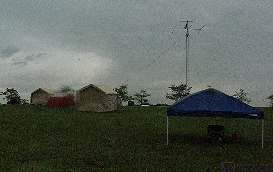 The ARRL FIeld Day event showcases the ability of amateur radio operators to set up equipment in the field on short notice and keep it on the air for 24 hours, no matter what.  The weather turned bad for the event.  The portable generator is under the tent in the right foreground.