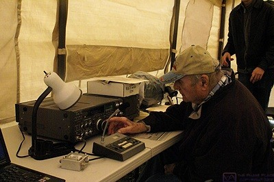 Jim (KC8WMW) stays dry as he works the GOTA (Get On The Air) station in one of the tents.