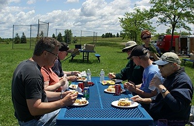 SLAARC members enjoying lunch outdoors at the Field Day site.
