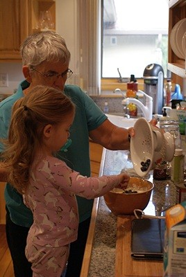 Madeline helps Grandma Linda mix the batter for vegan blueberry pancakes.