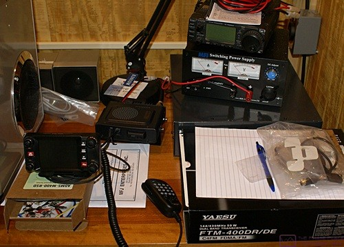 Part of our home ham radio shack with the new Yaesu FTM-400 2m/70cm mobile radio shown lower left.