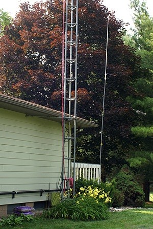 The new Diamond X-300NA VHF/UHF ham radio antenna is visible atop the pole at the corner of the deck.