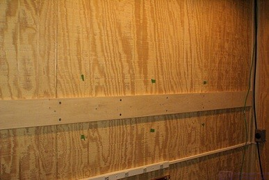 The ZioTek tracks will mount to the horizontal poplar board which will be mounted to the wall at the studs.