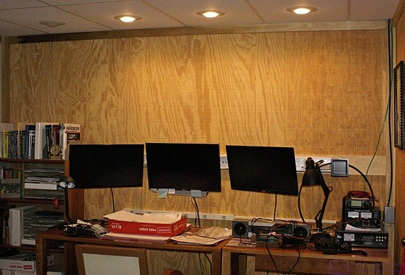 All three monitors mounted in the ham shack using the ZioTek wall-mounted track system.  The Dell is in the middle.  There is a mount and room for one more monitor at the right end.