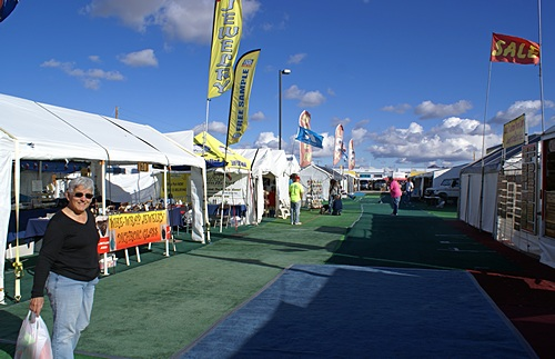 Some of the vendor tents in the Tyson Wells market area on the south side of Kuehn Street.