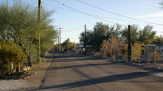 View looking south on Lollipop Ln from the entrance to our compound.