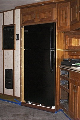 The pantry and refrigerator installed in the alcove.