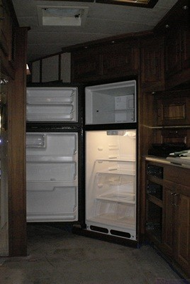 The new refrigerator in the alcove with the doors open.