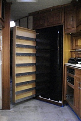 The pantry pulled out with the refrigerator installed.