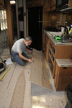 Bruce positions the second piece of underlayment.