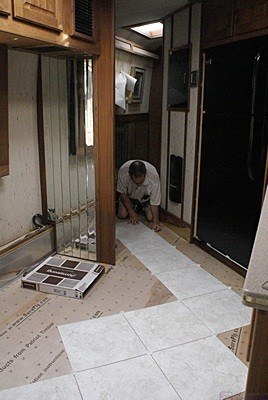 Dry fit of Armstrong Alterna floor tiles.  The starting point was where the kitchen was where the kitchen transitions into the hallway.