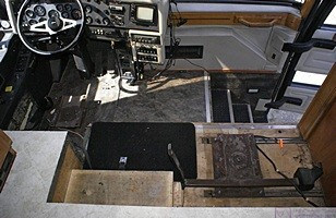 A view of the cockpit of our bus with the old Villa pilot and co-pilot/navigator seats removed.  This shot is from the living room looking forward.