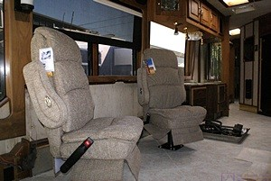 The two class C captain's chairs installed on the passenger side of the living room.