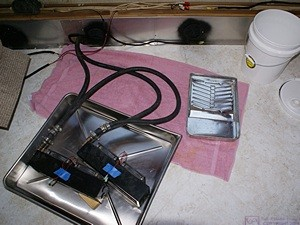 The two fan-coil heat exchangers in the photo tray ready to have the coolant hoses disconnected.