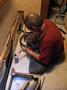 Bruce works on attaching the heater hoses to the fill/bleeder valve T assembly he built.