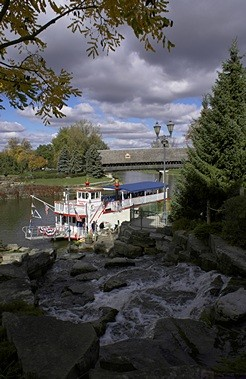 This paddleboat travels a short ways up the river and back.  The cascading waterfall is man-made.  The covered bridge in the background handle automobile traffic going to the Frankenmuth Bavarian Inn on the other side of the river from Main Street.