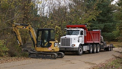 A closer view of Phil's truck and excavator.  He can move a lot of dirt, rock, and anything else he wants with this thing.