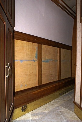 The lower outside hallway wall.  There were originally three framed panels of vertical strip mirrors here.  We will replace them with wood panels, probably in a lighter color to contrast with the walnut trim.