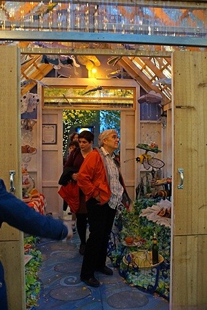 Linda (front) and Kate (behind) take in the interior of one of the Pop-X art exhibit sheds.