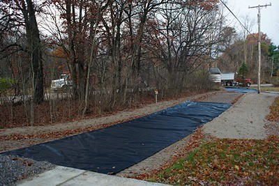 Construction fabric in place on the upper and lower portions of the driveway extension.