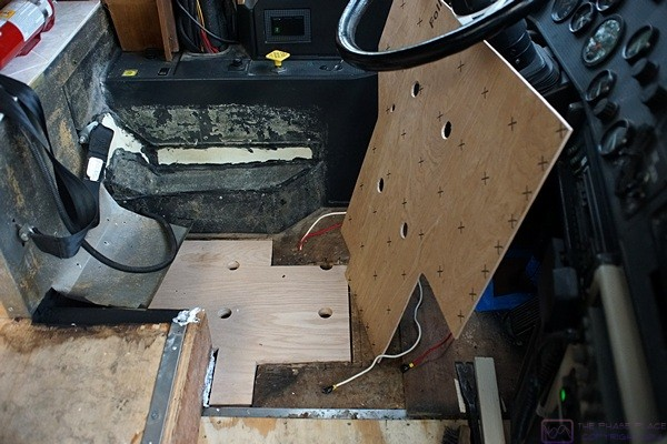 Yet another layer of plywood to fill in and even up the floor under the driver's seat in the bus.