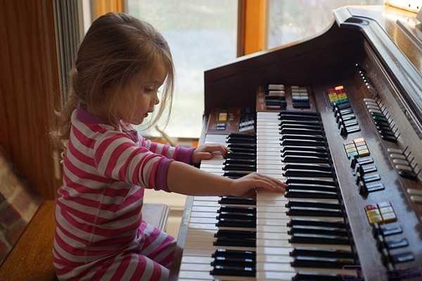 "Madeline plays (at) the organ.  It is one of her favorite ""toys"" at our house."