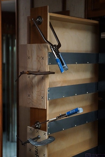"The 1/4"" walnut veneered plywood clamped to the front of the pull-out pantry."