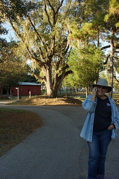 Linda on the phone with Diane Rauch as we head into the older south section of the resort.  That's one happy girl.