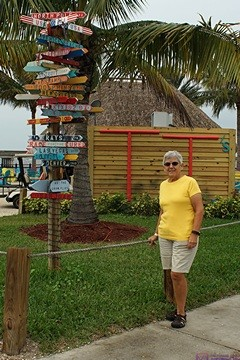 Linda by the signposts at the Charlotte Harbor Sheraton Four Points Hotel, Punta Gorda, FL.