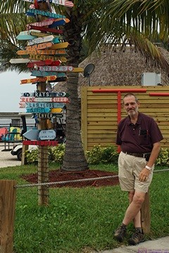 Bruce by the signposts at the Charlotte Harbor Sheraton Four Points Hotel, Punta Gorda, FL.