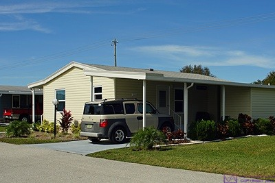 Ed & Betty's place at Gold Tree MH community in Bradenton, Florida with our car in the driveway.