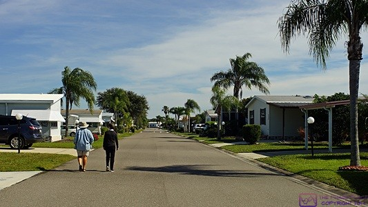 Linda and Betty strolling down one of the interior roads at the Gold Tree MH community.
