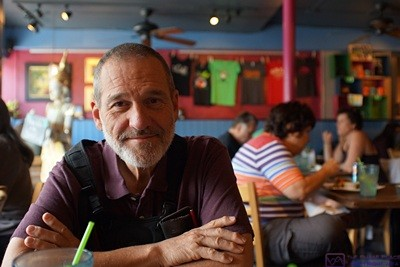 A rare photo of me taken by Linda.  Even rarer is that I am smiling.  But then, why not?  I'm at The Cafe in Key West, Florida with my bride of almost 45 years about to enjoy a wonderful vegan meal.  It doesn't get much better than that.