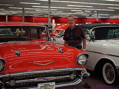 Bruce standing by a red 1957 Chevy Belair.  He had one very similar to this when he was in high school.  Muscle Car Museum, Punta Gorda, FL.